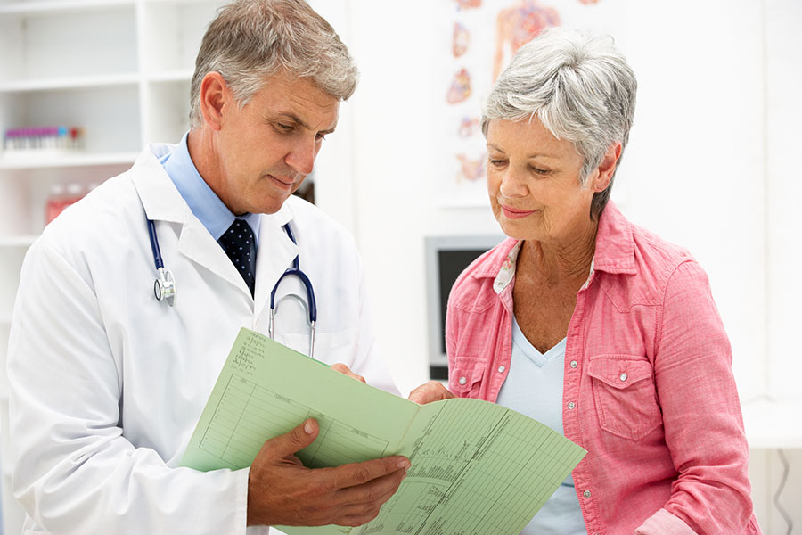 Doctor Reviewing Medical Information